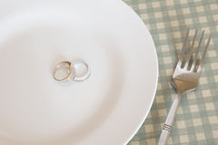 Wedding rings on plate with fork Stock Photos