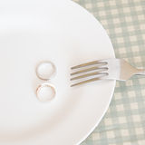 Wedding rings on plate with fork Stock Images