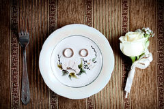 Wedding rings on the plate. Wedding rings on the willow plate Royalty Free Stock Image