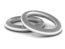 Wedding rings. Platinum engagement wedding rings on white background Stock Image