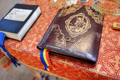 Wedding rings on prayer book. In Orthodox church Royalty Free Stock Photography