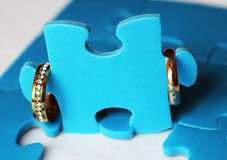 Wedding rings and puzzles. Idea Royalty Free Stock Image