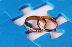 Wedding rings and puzzles. Idea Stock Image