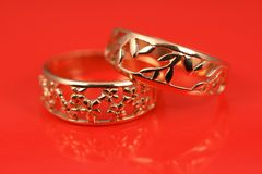 Wedding rings on red Royalty Free Stock Images
