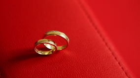 Wedding rings. On a red background stock footage