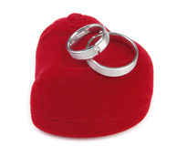 Wedding rings on red box Stock Photos