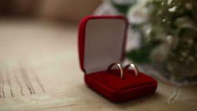 Wedding rings in the red box in the background. Wedding rings in  the red box in the background bridal bouquet video stock video