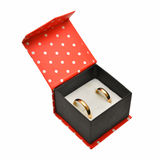 Wedding rings in red box. Isolated on white royalty free stock image