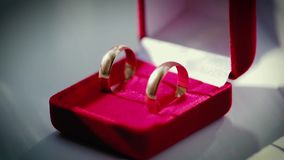Wedding rings in red box stock footage