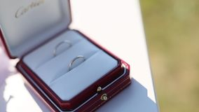 Wedding rings in a red box for rings stock footage