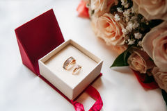 Wedding rings in red box with rose. On white background Stock Photos