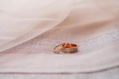 Wedding rings in red box on textile background Royalty Free Stock Images