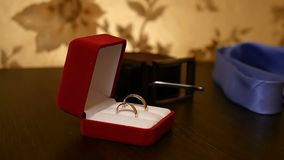 Wedding rings in the red box on the video table. Wedding rings in the red box on video table stock video