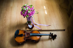 Wedding rings in the red box, a violin and bow Royalty Free Stock Photos