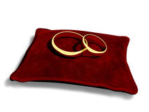 Wedding rings on a red cushion Stock Photo