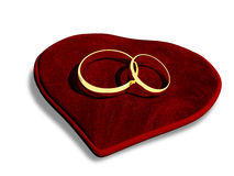 Wedding rings on a red cushion Royalty Free Stock Photo
