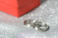 Wedding rings with a red gift Stock Photography