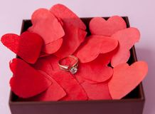 Wedding rings on the red hearts. Pink background. The concept of betrothal, divorce, parting, infidelity .Selective focus.  royalty free stock photos