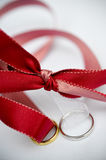 Wedding rings and red ribbon Stock Photography