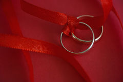 Wedding rings with red ribbon Royalty Free Stock Photo