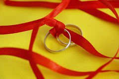 Wedding rings with red ribbon Royalty Free Stock Images