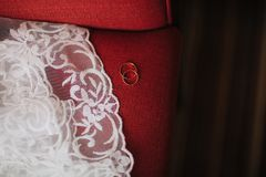 wedding rings on a red sofa wedding dresses Royalty Free Stock Photos
