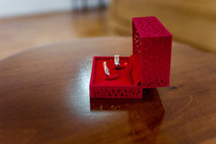 Wedding rings in a red square box Royalty Free Stock Photo