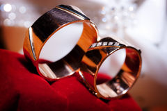 Wedding rings on the red textile. Wedding rings on the willow red textile Royalty Free Stock Image