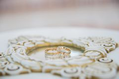 Wedding rings with reflection in mirror. Wedding rings on the mirror surface stock image