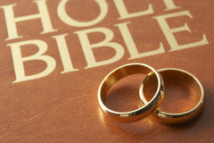 Wedding Rings Resting On A Bible. Wedding Rings Resting On A Holy Bible Royalty Free Stock Image