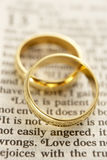Wedding Rings Resting On A Bible. Wedding Rings Resting On A Holy Bible Stock Photography