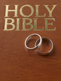 Wedding Rings Resting On A Bible. Wedding Rings Resting On A Holy Bible Royalty Free Stock Photography