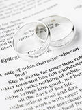 Wedding Rings Resting On A Bible. Wedding Rings Resting On A Holy Bible Stock Photo