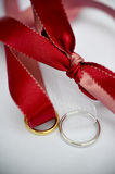 Wedding rings and ribbons Royalty Free Stock Images