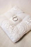 Wedding rings on ring barer pillow Royalty Free Stock Photography