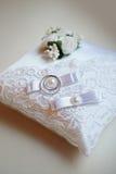 Wedding rings on ring barer pillow Stock Photo