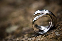 Wedding rings on a rocky background. With vignette effect Royalty Free Stock Photos