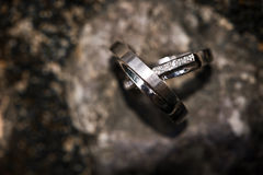 Wedding rings on a rocky background Stock Image