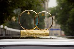 Wedding rings on the roof of the car Royalty Free Stock Photo
