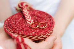 Wedding rings on a rope. Hands of bride and groom Stock Photography