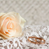 Wedding rings and rose. Wedding lace, two gold rings and rose Stock Photography