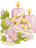 Wedding rings with rose and candle Royalty Free Stock Image