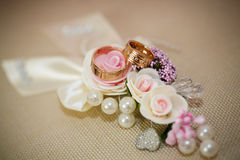 Wedding rings with rose flowers Stock Image