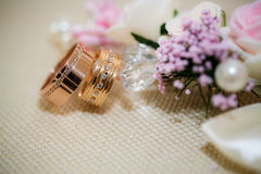 Wedding rings with rose flowers Stock Images