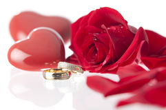 Wedding rings and rose.GN. Wedding rings with a red rose and laying on a glass surface.GN stock photography