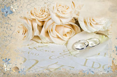 Wedding rings on rose petal with seashells Stock Photos