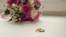 Wedding rings and rose. Wedding jewelry and rings. The Beauty Wedding Ring on a box. Golden wedding rings stock footage