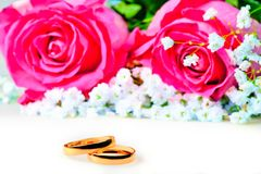 Wedding rings with rose on a white Royalty Free Stock Photos