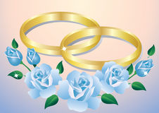 Wedding rings and roses. Stock Photo