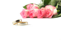 Wedding rings and roses. On white background Royalty Free Stock Images